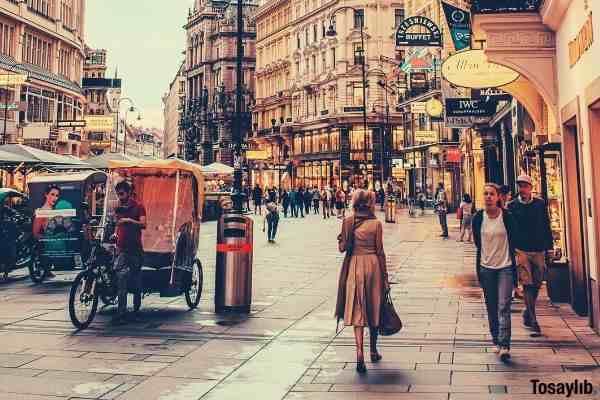 people walking beside berlitz building