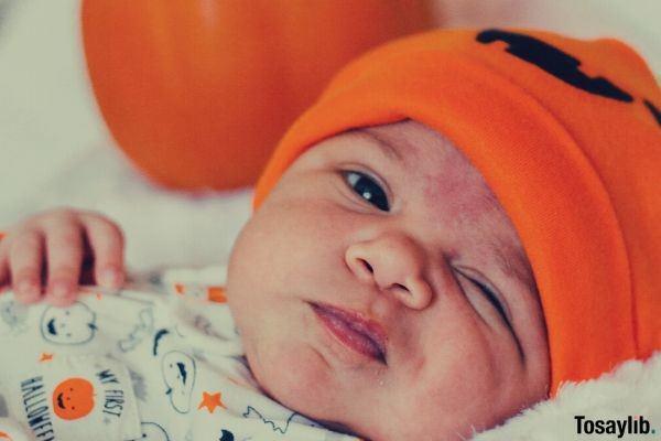 01 baby wearing orange knit cap