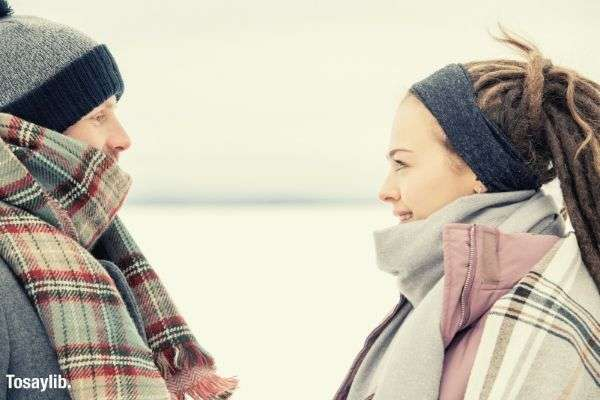 01 couple wearing scarves staring each other