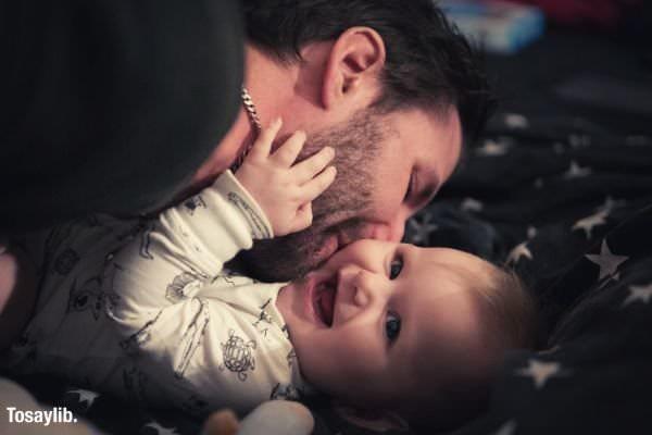 02 man kissing baby laughing