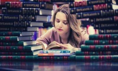 girl-in-pink-long-sleeves-reading-book