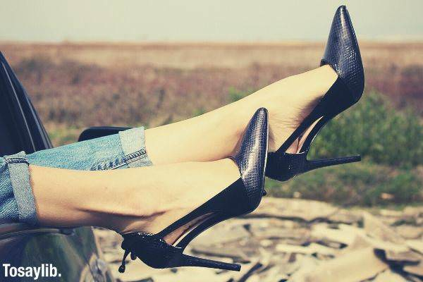 pair of black leather pointed toe pumps