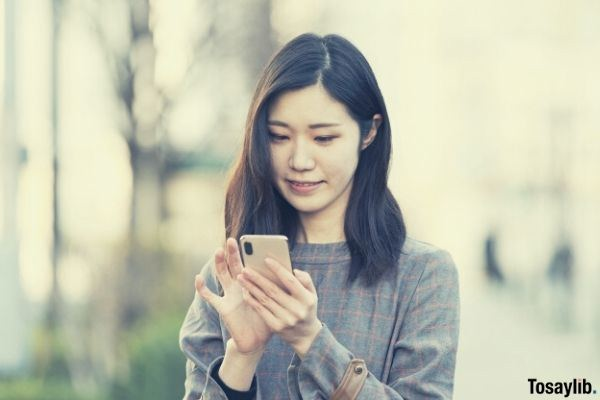 pretty woman using smartphone and smiling