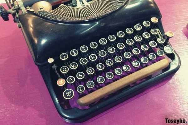 old antique vintage alphabet typewriter pink table