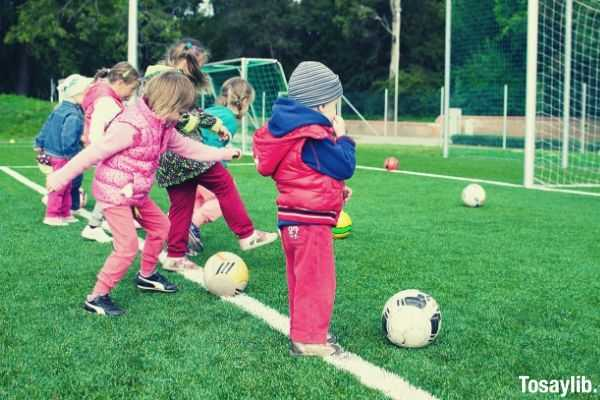 action activity kids playing soccer balls on soccer field