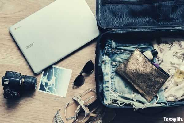 black dslr camera near laptop photo and bag