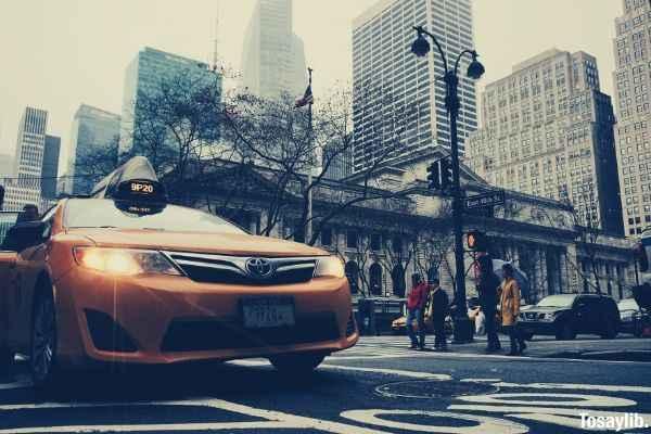 yellow toyota sedan taxi on highway road