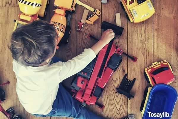 kid having fun playing his toy