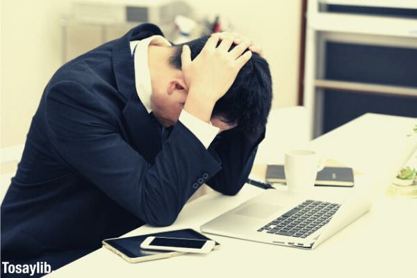 businessman stressed holding his head sitting