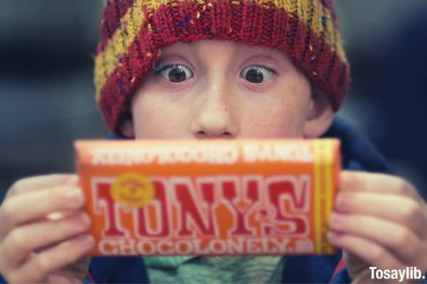 boy holding tony s chocolonely bar pack