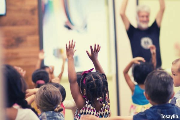 children lifting hands inside the classroom