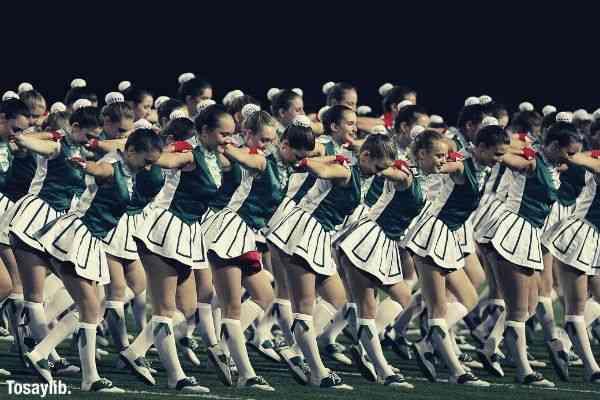 action cheerleaders cheerdance green white uniform field