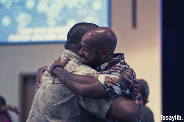 two man hugging focus photography bokeh