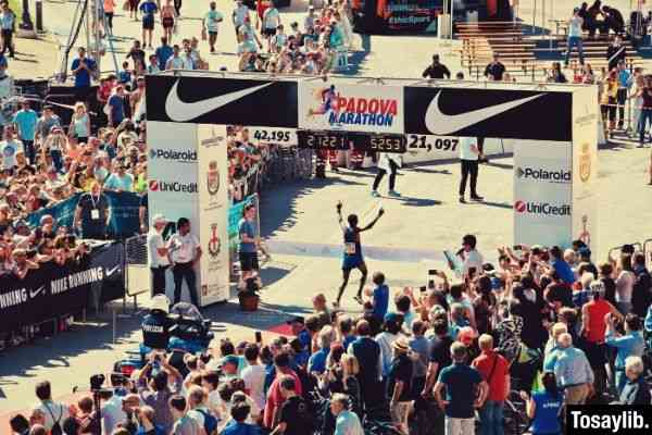 many people watching padova marathon during daytime photo