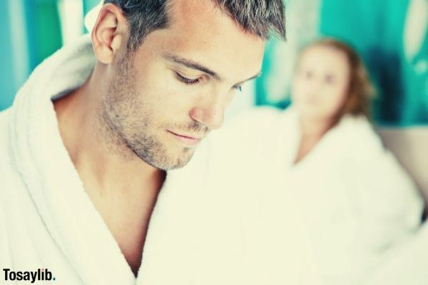 man wearing white robe beside woman