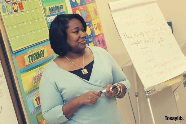 photo of woman teaching black american pen illustration
