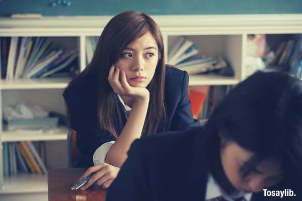 japanese student thinking wearing black blazer