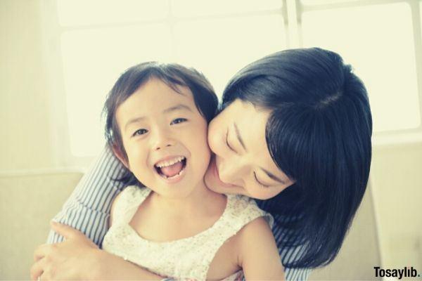 mother hugging her child smiling