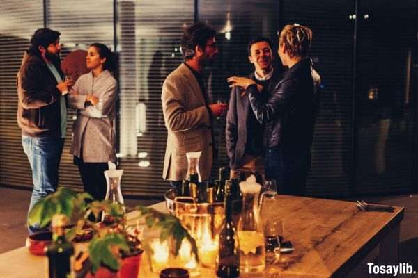 03 photo of five people in formal attire table drinks plant