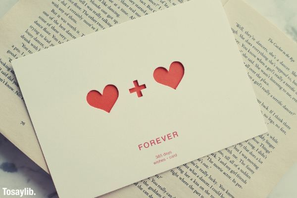 white paper postcard with heart plus heart forever