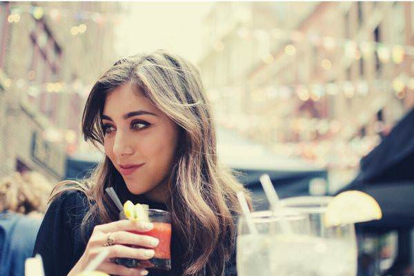 beautiful-girl-with-brown-hair-holding-beverage-in-new-york