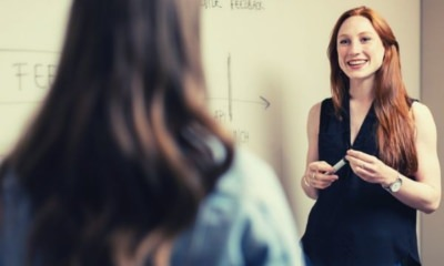 female-engineer-holding-sharpee-presenting-to-another-woman