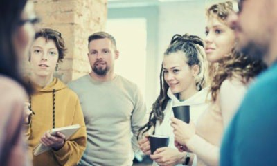 photo-of-people-standing-while-discussing