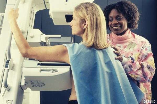 black woman standing beside another woman mamogram