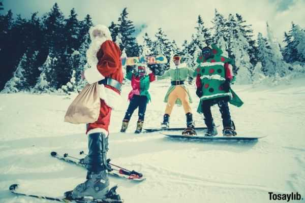 santa claus and friends riding snow board