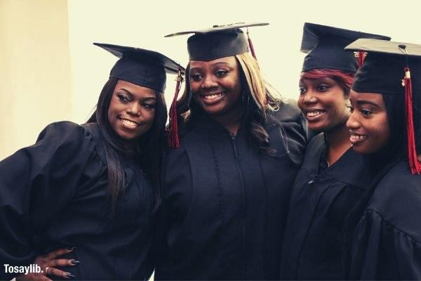 black americans women picture taking graduation photo