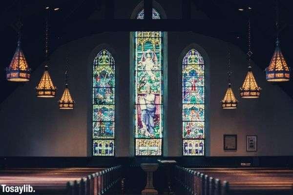 church interior design mosiac windows and chairs