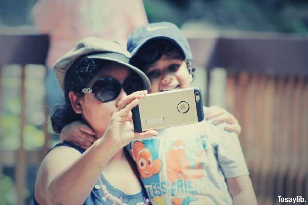 young mom and son selfie snapping picture from mobile device