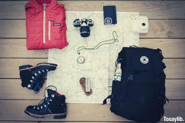 black hiking backpack fujifilm stax mini camera shoes red jacket
