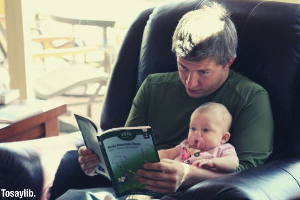 01 family reading reading dad kids parenthood parenthood fatherhood daddyslittlegirl faughter daughter
