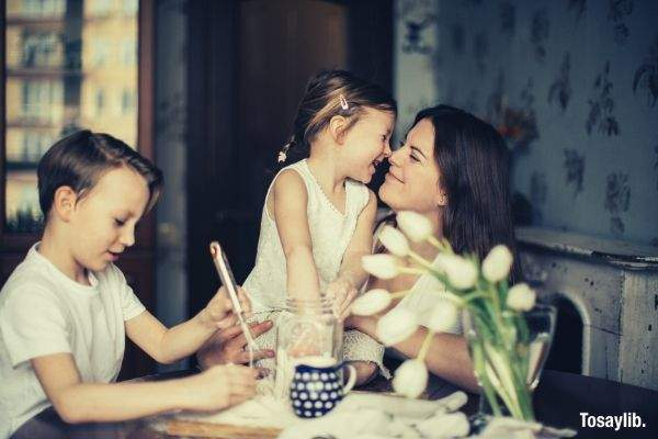 04 photo of woman playing with her children whisk