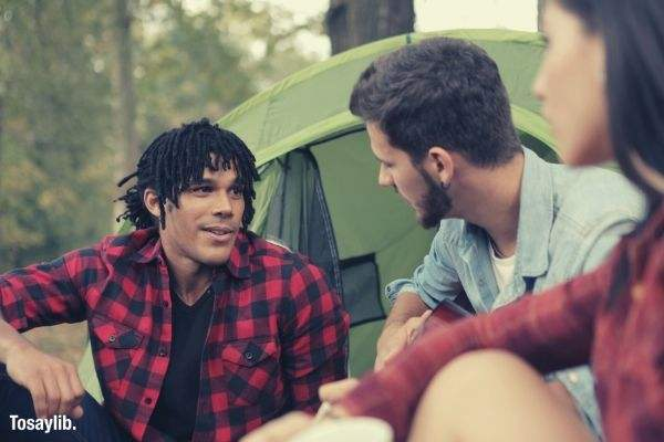 05 multiethnic young people talking at campsite