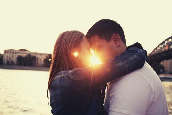 couple-man-white-shirt-woman-denim-jacket-kissing-sunset-lovers