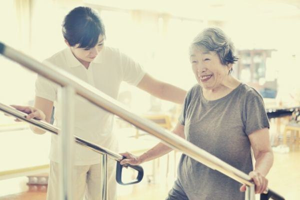 grandmother-in-gray-shirt-smiling-while-having-therapy-session-from-the-therapist