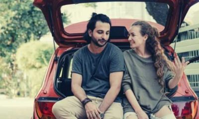 young-diverse-couple-relaxing-after-unpacking-car-while-moving-home-indian-american