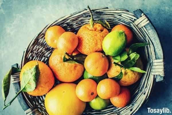 orange and lemon fruits inside a wicker basket