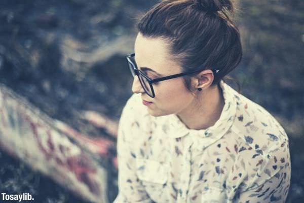 beautiful woman wearing eyeglasses eyewear wearing white blouse with flowers