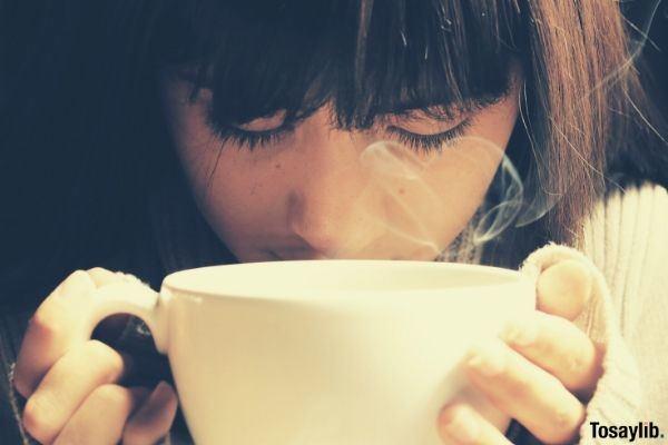 breakfast woman holding white mug coffee drinking