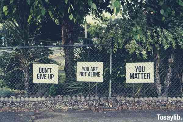 Dont give up you are not alone you matter rehab signage on fence