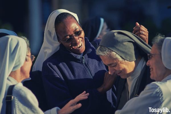 focus photo of group of nuns happy