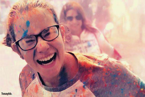 portrait paint colorful celebration bright party woman eyeglass smiling with paint on her face