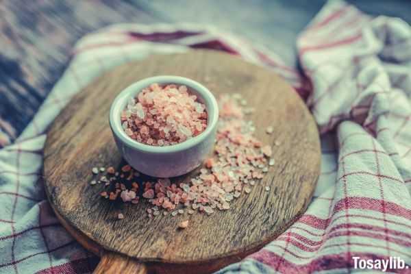close up photo of himalayan salt on wooden pan