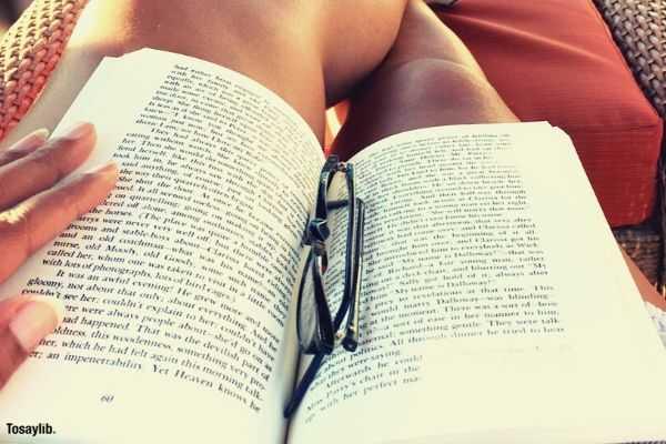 woman relax reading book eyeglasses sitting flip flops