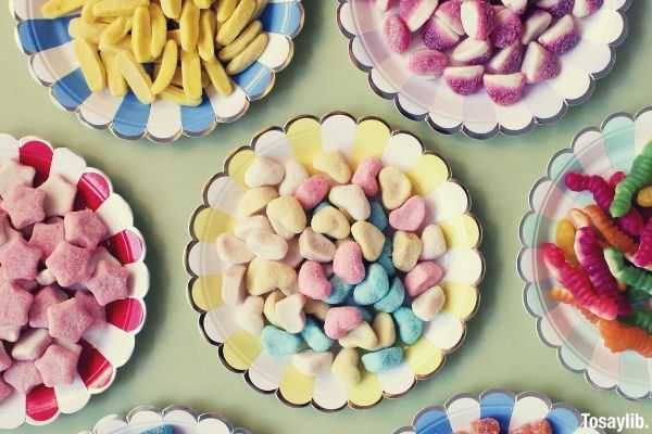 assorted candies on plate many plates different color candies