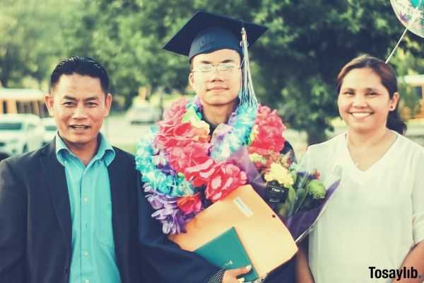 photo of a man wearing academic gown together with his parents