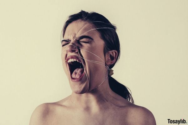 06 woman screaming with strings wrapped around her face